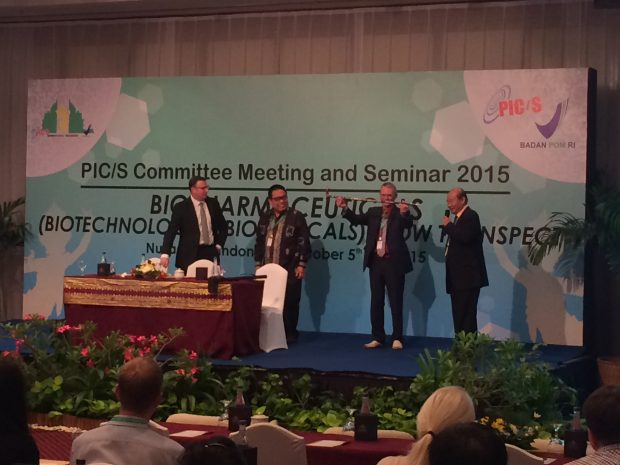 Paul Hargreaves, MHRA, UK receives the PIC/S walking stick in Indonesia