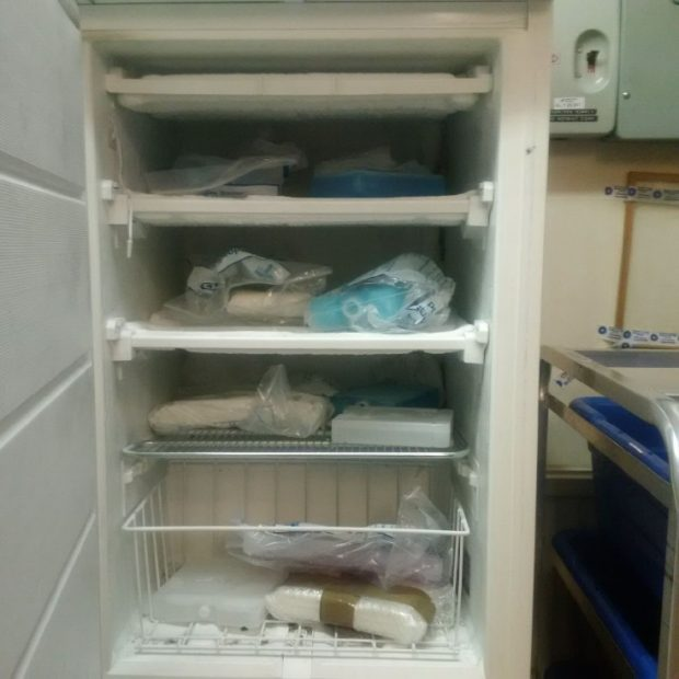 Cold packs stored in a small freezer.  Cold packs are wrapped in paper which poses a hygiene hazard.  There is a large variety of different types of ice packs with no control on this or how long the individual packs have been conditioned for.