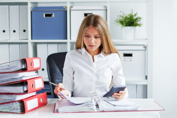 business woman studying some paperwork