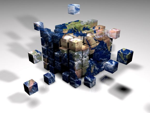 A cube built up of pieces of the globe, to show working together on a global basis