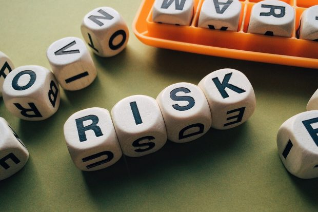 Scrabble pieces spelling the word 'risk'
