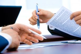 Two people discussing a technical agreement