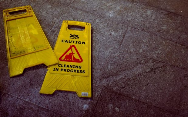 Yellow 'Cleaning in Progress' caution signs