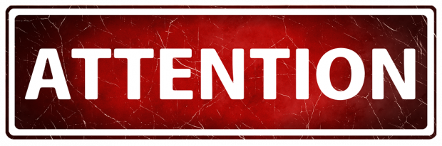 Banner displaying the word 'Attention' in white capitals on a red background