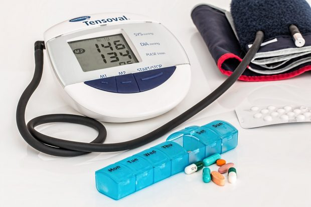 Blood pressure monitor and cuff with assortment of pharmaceutical tablets and capsules
