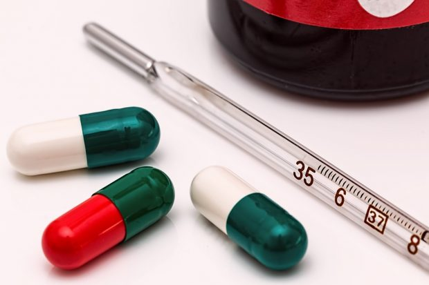 pharmaceutical capsules and a thermometer