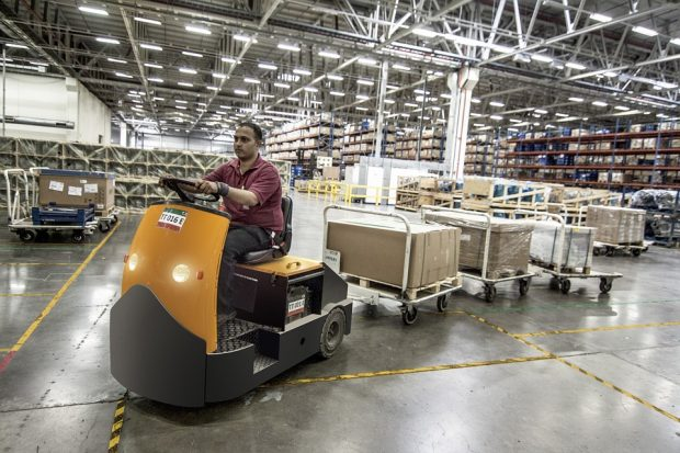 pallet truck driver moving cartons around a warehouse