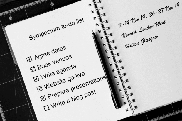 Notebook with a to do list:  Agree dates and book venues:  11 to 14 Nov 1029 at the Novotel London West and 26 26 to 27 November at the Hilton Glagow.  Write agenda, website go-live, prepare presentation and write a blog post