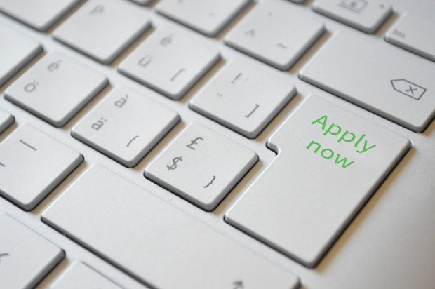 Keyboard with the words 'Apply now' on the return key